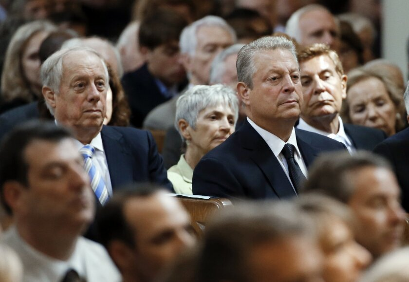 Former Vice President Al Gore, third from right, and former Tennessee Gov. Phil Bredesen, left, attend the funeral for John Seigenthaler on Monday, July 14, 2014, in Nashville, Tenn. Seigenthaler, a journalist who edited The Tennessean newspaper, helped shape USA Today and worked for civil rights during the John F. Kennedy administration, died July 11. He was 86. (AP Photo/Mark Humphrey)
