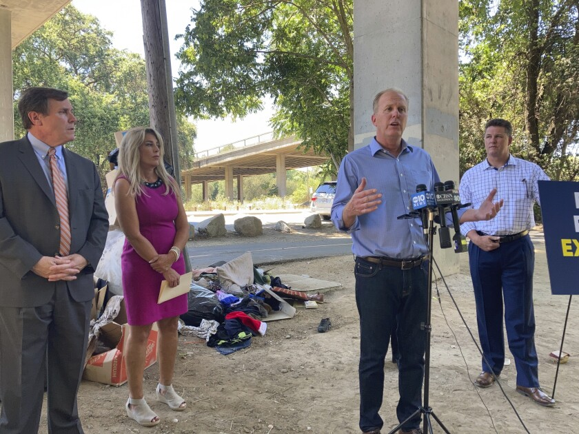 Republican gubernatorial candidate Kevin Faulconer outlines his plan to vastly expand homeless shelters in California during a news conference in Sacramento, Calif., Tuesday, June 29, 2021. Faulconer, the former mayor of San Diego, said he'd treat homelessness like an emergency in California. Faulconer was accompanied by Legislative Republican Leaders, Sen. Scott Wilk, of Santa Clarita, left, Assembly member Marie Waldron, of Escondido and Chico City Councilman Sean Morgan, right. (AP Photo/Kathleen Ronayne)