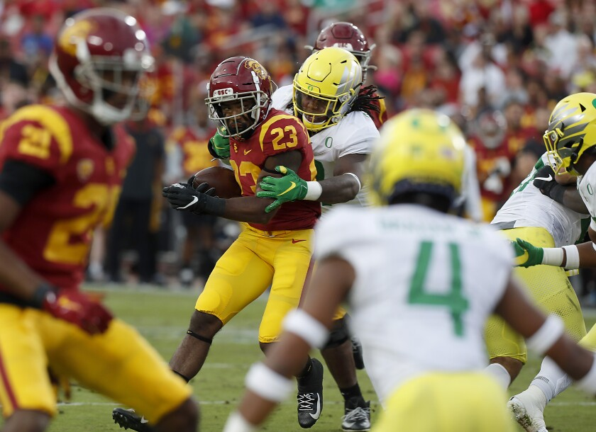 USC running back Kenan Christon looks for room to run against Oregon in the second quarter at the Coliseum on Saturday.