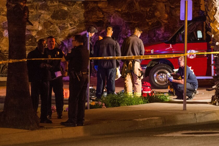 Police and paramedics at the scene of a fatal stabbing in Oceanside.