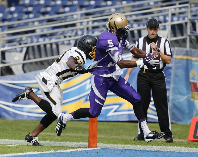 Saints receiver F. Buncom IV scores a touchdown in the first half during the Mission Bay vs. St. Augustine in Division II high school football championship Monday at Qualcomm Stadium.