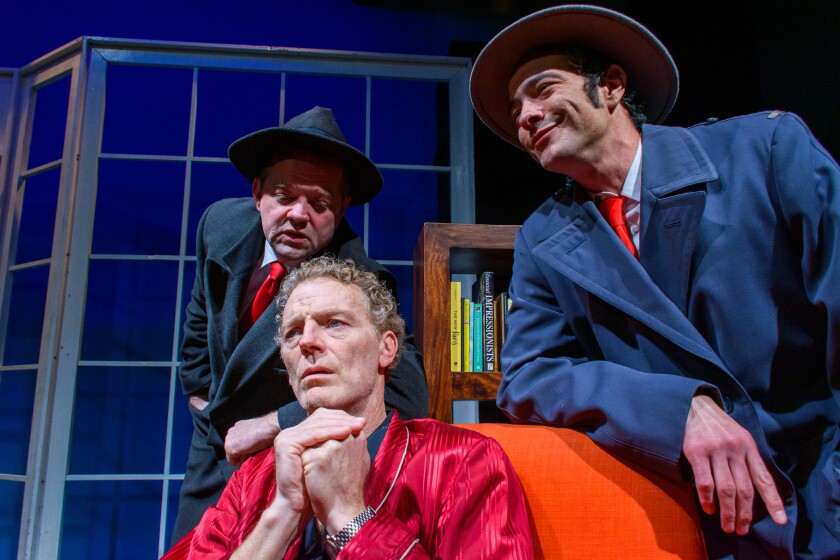 """A dissident writer (Troy Dunn, center) is menaced by government thugs (Aaron Bray, left, and Anthony Sannazzaro) in the Václav Havel play """"Largo Desolato"""" at City Garage."""