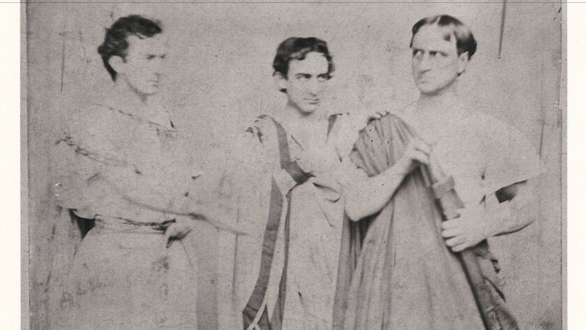 """The three Booth brothers in an 1864 production of """"Julius Caesar."""" From left: John Wilkes Booth as Marc Antony, Edwin Booth as Brutus and Junius Brutus Booth Jr. as Cassius."""