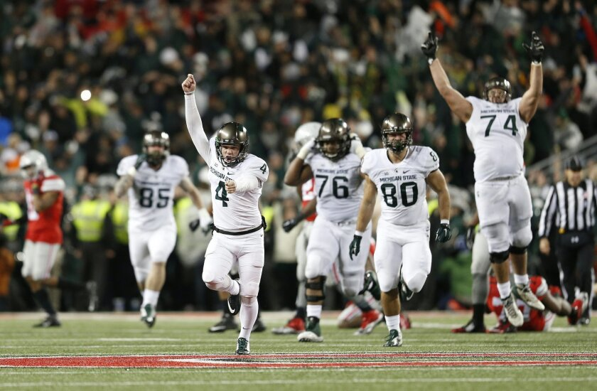 Michigan State kicker Michael Geiger (4) runs down the field in celebration after kicking the game-winning 41-yard field goal against Ohio State as time expired in the fourth quarter of an NCAA college football game Saturday, Nov. 21, 2015, in Columbus, Ohio. Michigan State won 17-14. (Adam Cairns/The Columbus Dispatch via AP) MANDATORY CREDIT