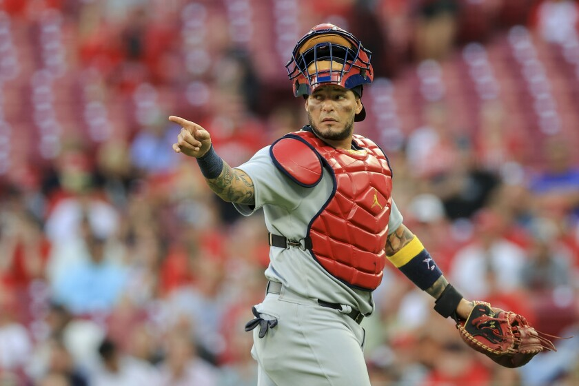 St. Louis Cardinals catcher Yadier Molina points to teammates during a game against the Cincinnati Reds.