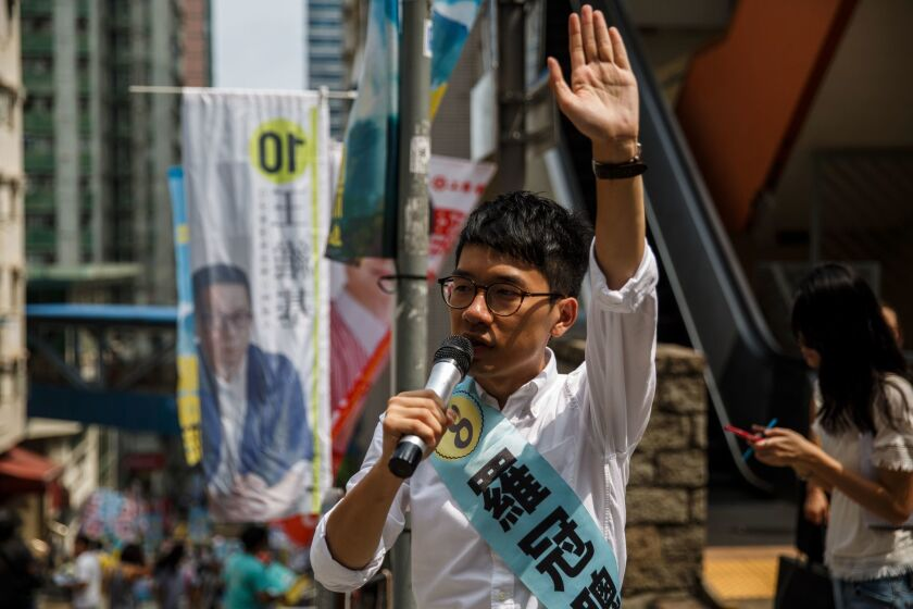 Nathan Law, 23, a leader of the 2014 pro-democracy rallies, campaigns for his political party Demosisto party during the Legislative Council election in Hong Kong on Sept. 4, 2016.