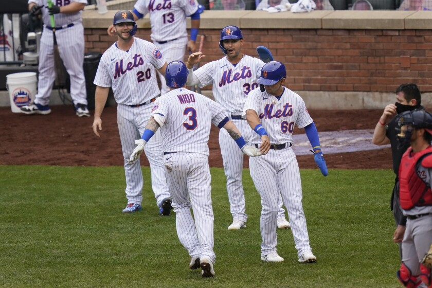 New York Mets' Tomás Nido (3) celebrates his grand slam with Pete Alonso, left, Michael Conforto, second from right, and Andres Gimenez during the fifth inning of a baseball game against the Washington Nationals at Citi Field, Thursday, Aug. 13, 2020, in New York. (AP Photo/Seth Wenig)