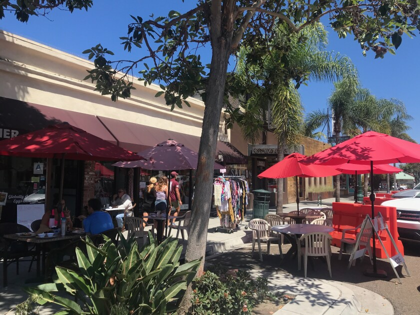 Eateries extend onto the street on Highway 101.