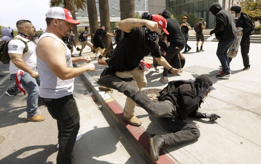 Protesters opposed to vaccine mandates brawl with counter-protesters outside LAPD headquarters.