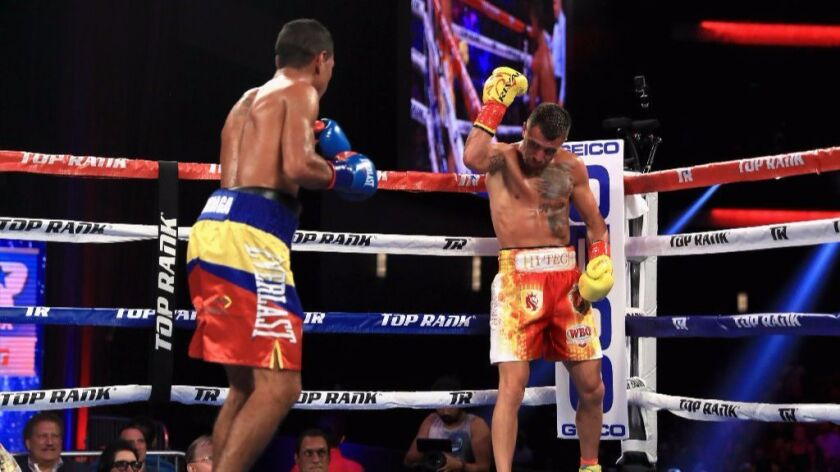 Vasyl Lomchenko, right, taunts Miguel Marriaga during their WBO super-featherweight title fight on S