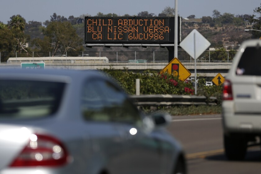 Drivers pass a display showing an Amber Alert asking motorists to be on the lookout for a specific vehicle in San Diego. The alert is now in effect in Oregon.