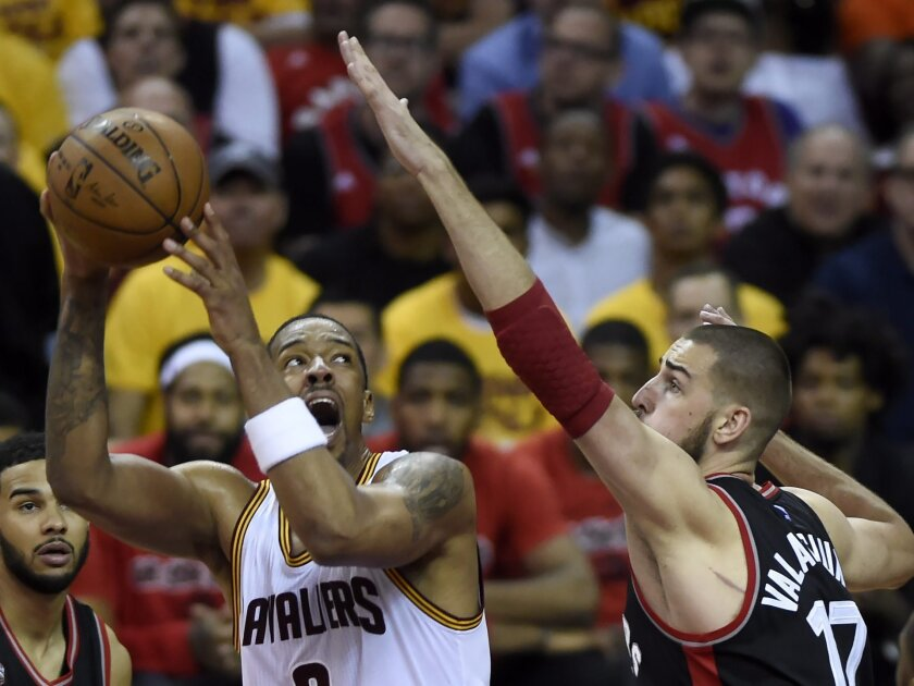 Cleveland Cavaliers forward Channing Frye looks to shoot as Toronto Raptors center Jonas Valanciunas defends during the second half of Game 5 of the NBA basketball Eastern Conference finals, Wednesday, May 25, 2016, in Cleveland. (Frank Gunn/The Canadian Press via AP)