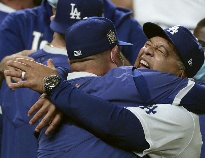 Dodgers manager Dave Roberts celebrates with the team after clinching the World Series.
