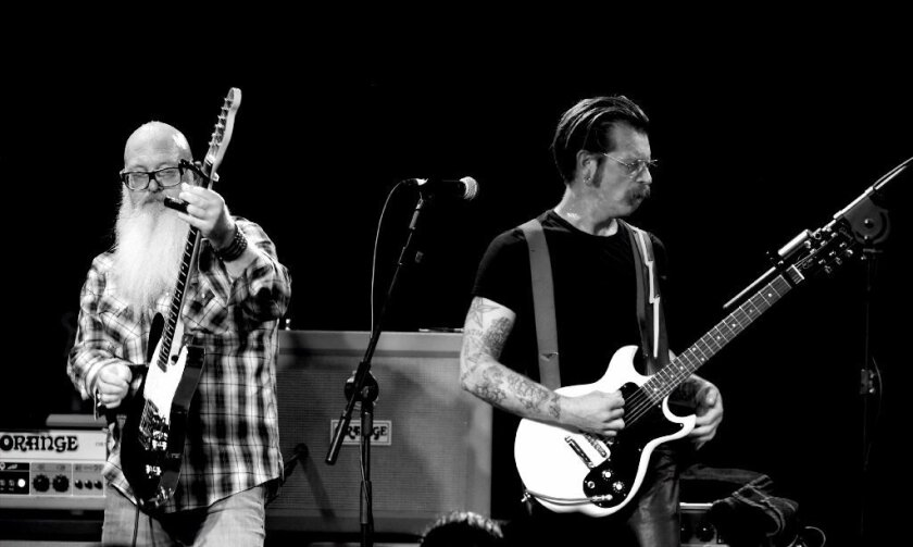 Dave Catching, left, and Jesse Hughes of Eagles of Death Metal perform in Los Angeles in October.
