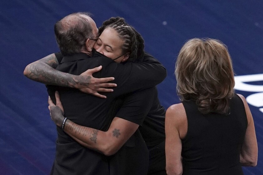 Los Angeles Sparks assistant coach and former Minnesota Lynx star Seimone Augustus, second from left, greets Lynx owners Glen and Becky Taylor before a WNBA basketball game Saturday, June 12, 2021, in Minneapolis. (Anthony Souffle/Star Tribune via AP)