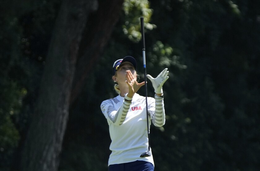 Nelly Korda, of the United States, reacts after a shot from the 17th fairway during the third round of the women's golf event at the 2020 Summer Olympics, Friday, Aug. 6, 2021, at the Kasumigaseki Country Club in Kawagoe, Japan. (AP Photo/Darron Cummings)