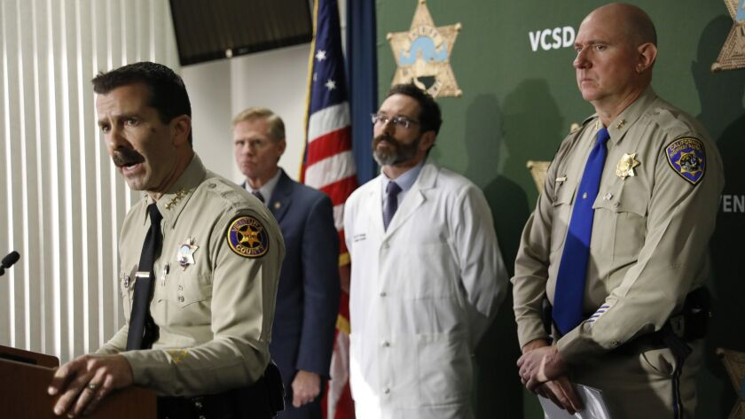 THOUSAND OAKS, CA-DECEMBER 7, 2018: Bill Ayub, left, Sheriff of Ventura County, addresses the media