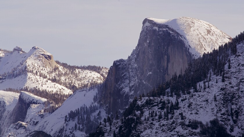 Recent storms have capped Half Dome and the Yosemite high country with snow in Yosemite National Park.