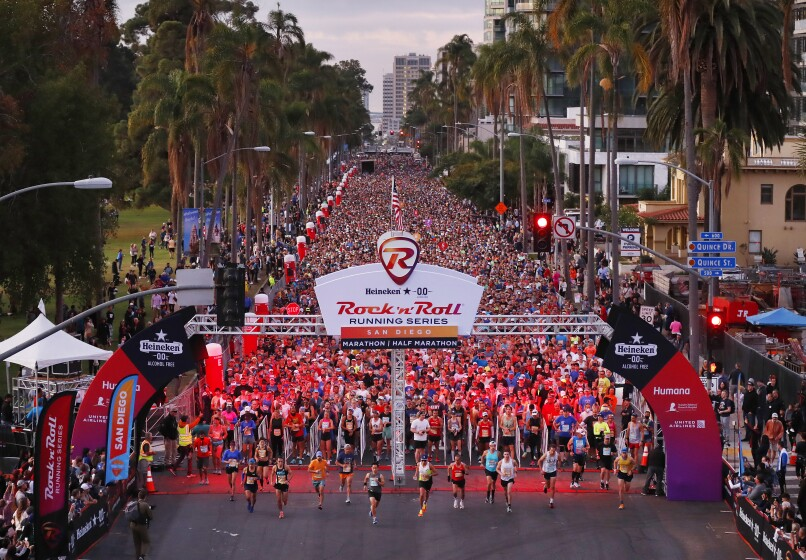 Nearly 20,000 runners start the Rock 'n' Roll Marathon and Half.