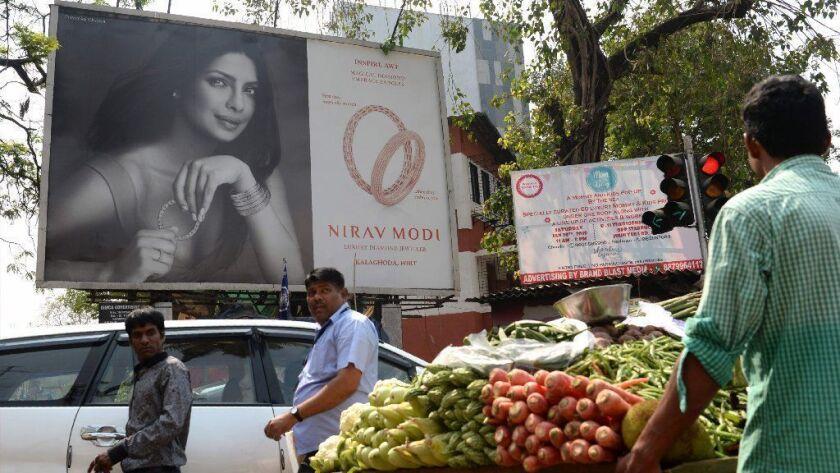 Actress Priyanka Chopra promotes jeweler Nirav Modi's luxury brand on a billboard in Mumbai, India.