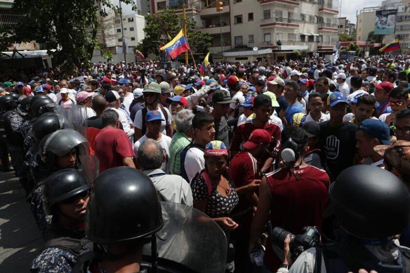 View of the opposition protest in Caracas on Saturday, March 9, 2019, called by the speaker of the legislature, Juan Guaido, recognized as acting president of Venezuela by some 50 countries; the demonstration was eventurally scattered with tear gas by the Bolivarian National Police (PNB). EFE-EPA/Rayner Peña