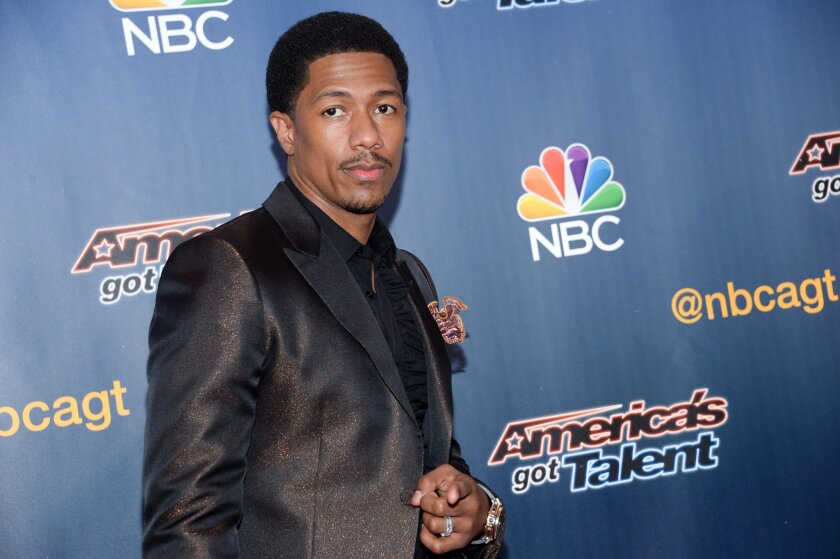 "FILE - In a Tuesday, July 29, 2014 file photo, host Nick Cannon arrives at the ""America's Got Talent"" pre-show red carpet at Radio City Music Hall, in New York. Scholastic announced Tuesday, Sept. 2, 2014 that Cannon's ""Neon Aliens Ate My Homework and Other Poems"", a book of poems for children, will be published in March 2015. (Photo by Evan Agostini/Invision/AP, File)"