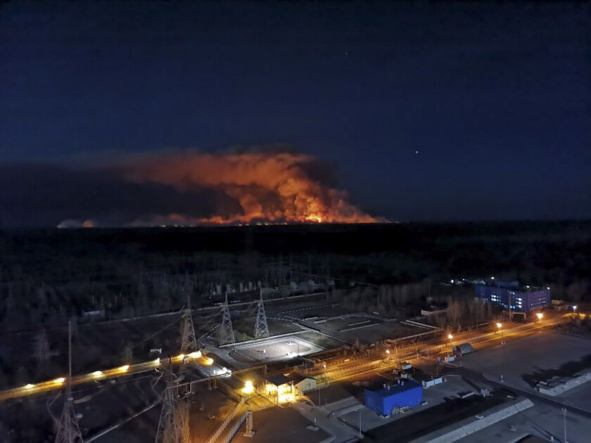 In this photo taken from Ukraine's shuttered Chernobyl nuclear plant last year, a forest fire is seen burning.