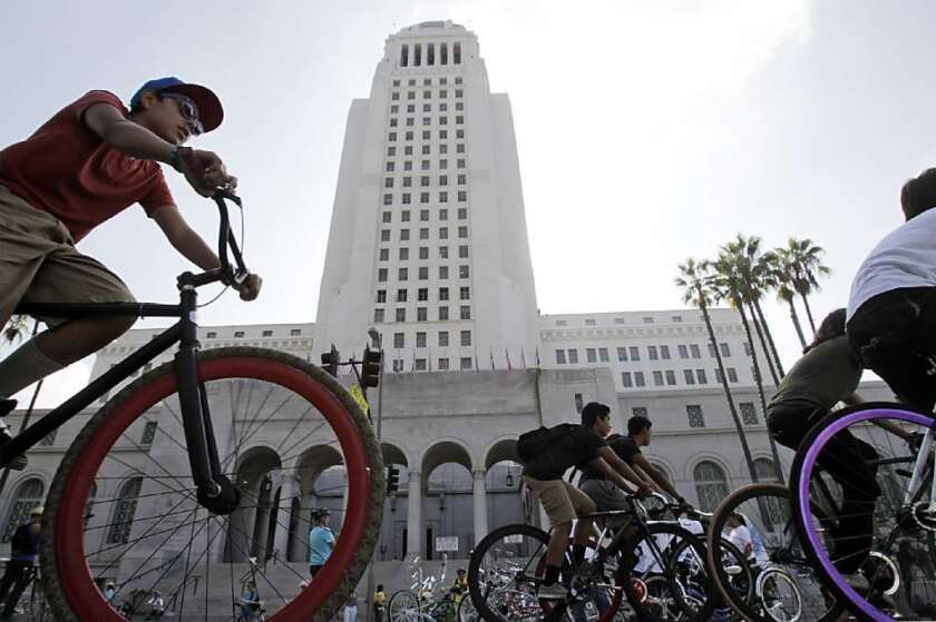 Cyclists pass L.A. City Hall during a CicLAvia event in 2012.