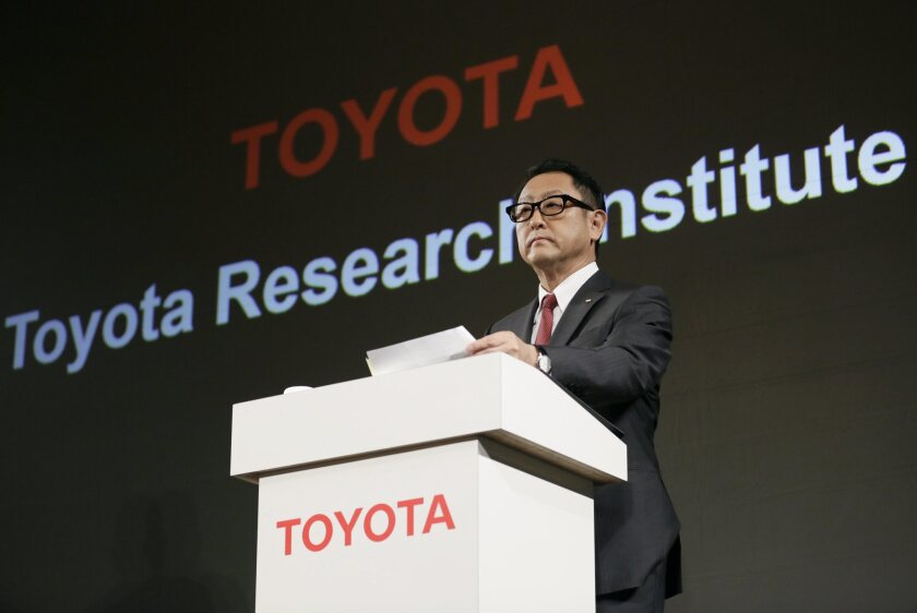Akio Toyoda, president of Toyota Motor Corp., announces Nov. 6, 2015, during a news conference in Tokyo that Toyota will establish a new artificial intelligence research and development company.