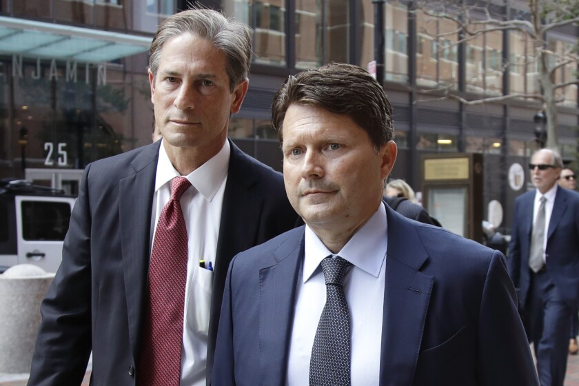 Devin Sloane, right, arrives at federal court in Boston for sentencing in a nationwide college admissions bribery scandal.