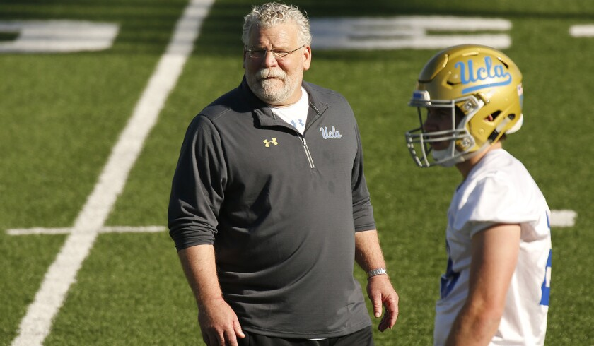 UCLA defensive coordinator Jerry Azzinaro instructs players during practice.