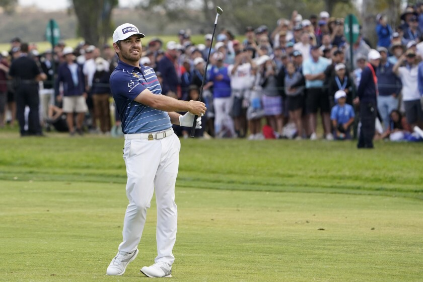 Louis Oosthuizen hits from the 18th fairway during the final round of the U.S. Open at Torrey Pines Golf Course on Sunday.
