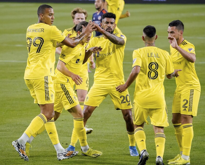 Nashville SC forward Jhonder Cadiz (99) celebrates his goal against FC Cincinnati during the first half of an MLS soccer match in Nashville, Tenn., Saturday, April 17, 2021. (Andrew Nelles/The Tennessean via AP)