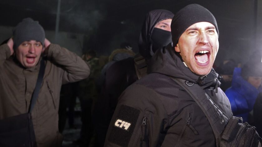 A protester shouts slogans during a rally in front of the Russian embassy in Kiev, Ukraine, Sunday,