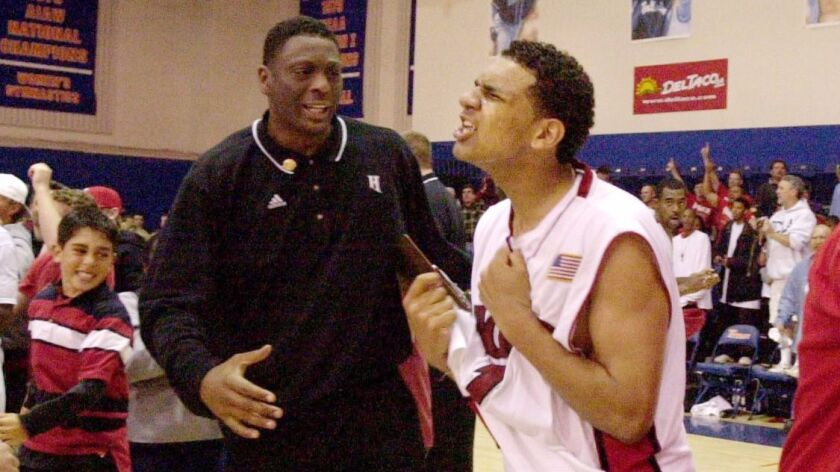 Horizon High School's Jared Dudley, center, celebrates his team's win over Garces Memorial at Cal St