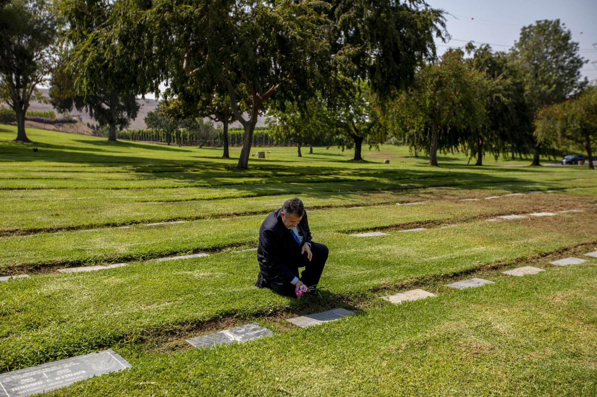 Trino Jimenez visits his brother's grave at Resurrection Cemetery in Rosemead.