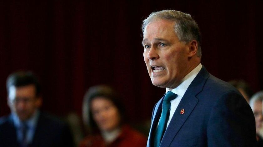 Washington Gov. Jay Inslee speaks Feb. 14 at an event in Seattle held by the Alliance for Gun Responsibility.