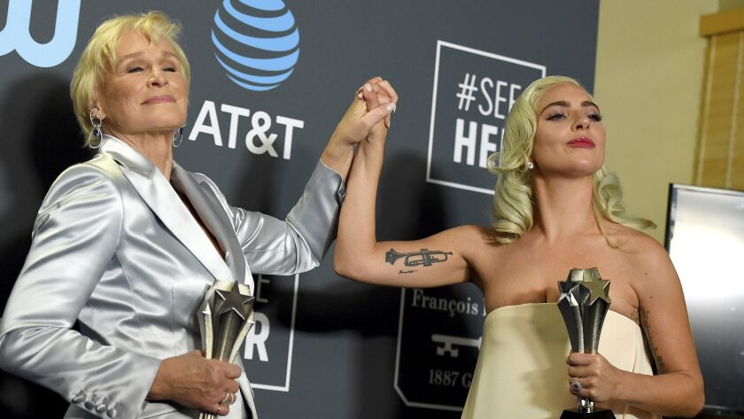 Glenn Close, left, and Lady Gaga tie as winner for the best actress award at the 24th Critics' Choice Awards at the Barker Hangar in Santa Monica.