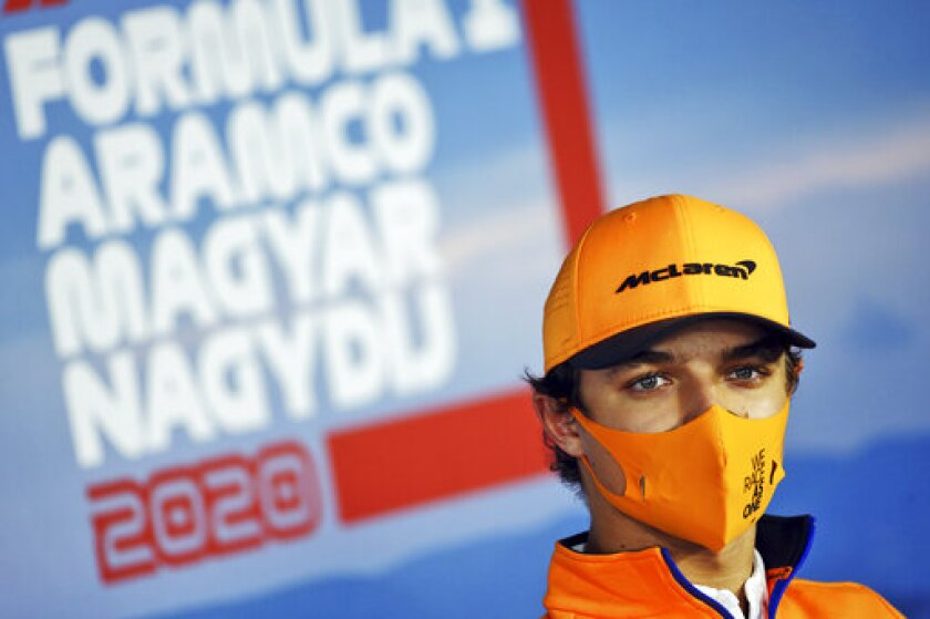 Mclaren driver Lando Norris of Britain attends drivers news conference at the Hungaroring racetrack in Mogyorod, Hungary, Thursday, July 16, 2020. The Hungarian Formula One Grand Prix race will take place on Sunday. (FIA Pool via AP)