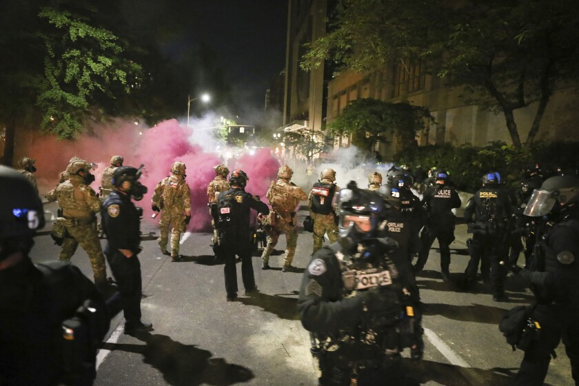 Militarized federal agents deployed by the president to Portland, fired tear gas against protesters.