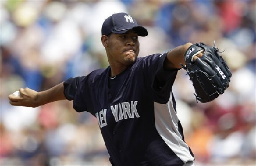 New York Yankees starting pitcher Ivan Nova throws against the New York Mets in the first inning of a spring training baseball game in Port St. Lucie, Fla., Tuesday, April 3, 2012. (AP Photo/Patrick Semansky)