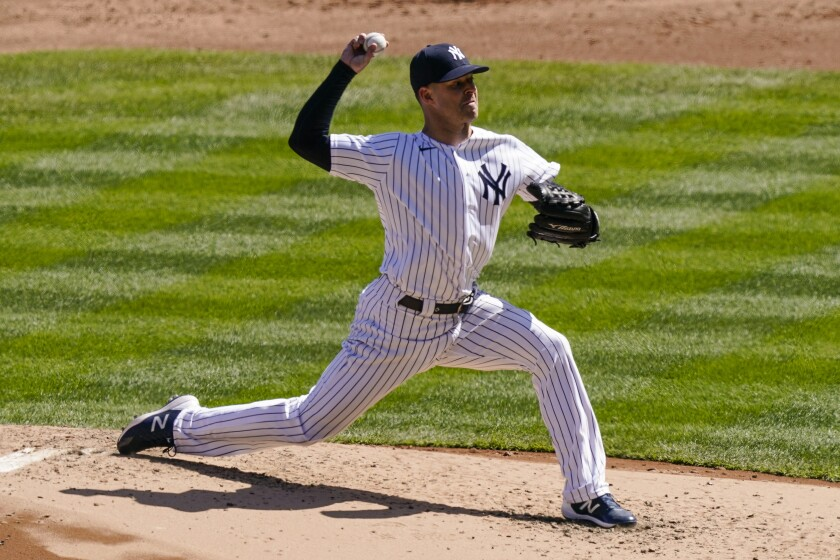 New York Yankees starting pitcher Corey Kluber throws during the third inning of a baseball game against the Toronto Blue Jays, Saturday, April 3, 2021, in New York. (AP Photo/John Minchillo)