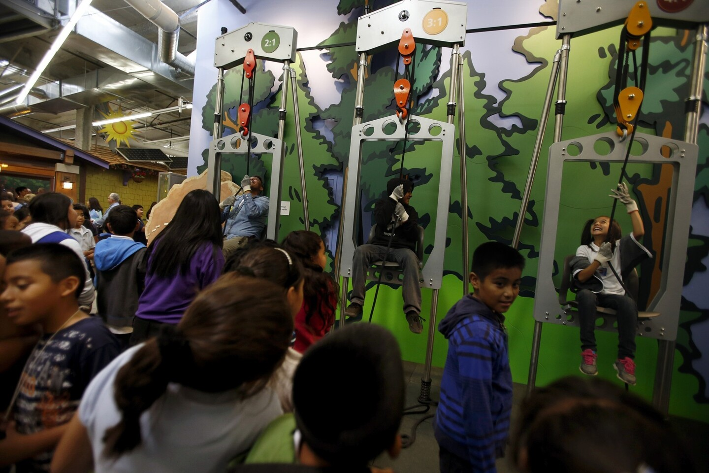 Students have fun with the power of pulleys on opening day of the Discovery Cube Los Angeles science museum in the San Fernando Valley.