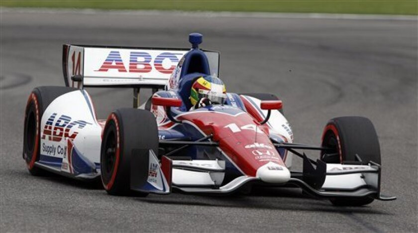 Mike Conway, of England, races during qualifying for the Grand Prix of Alabama IndyCar auto race at Barber Motorsports Park on Saturday, March 31, 2012, in Birmingham, Ala. (AP Photo/Butch Dill)