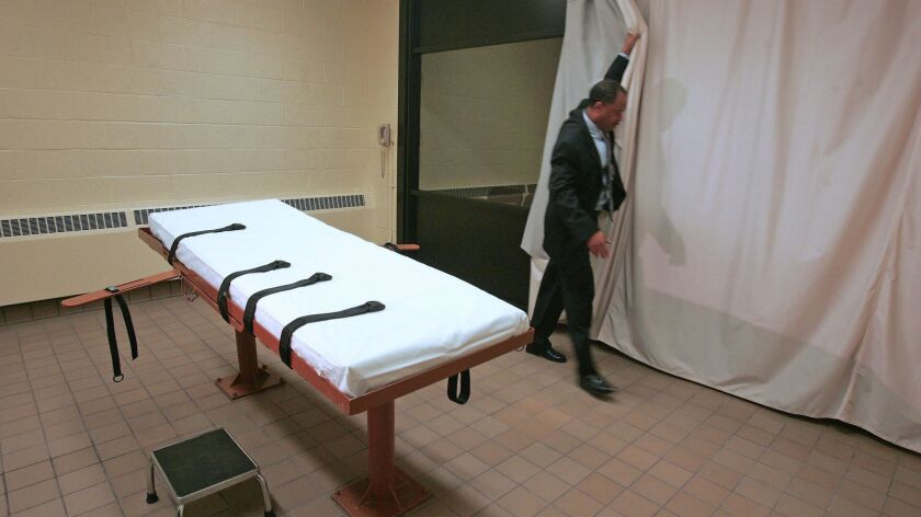 A curtain is pulled between the death chamber and witness room at the prison in Lucasville, Ohio. in Nov. of 2005.