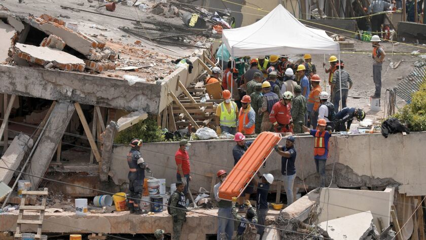 Rescue teams continue searching for students trapped in the rubble at Enrique Rebsamen school in Mex
