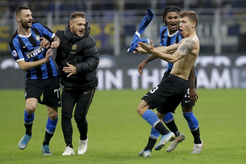 Inter Milan's Nicolo Barella, right, celebrates after scoring his side's second goal during the Serie A soccer match between Inter Milan and Hellas Verona, at the San Siro stadium in Milan, Italy, Saturday, Nov. 9, 2019. (AP Photo/Luca Bruno)