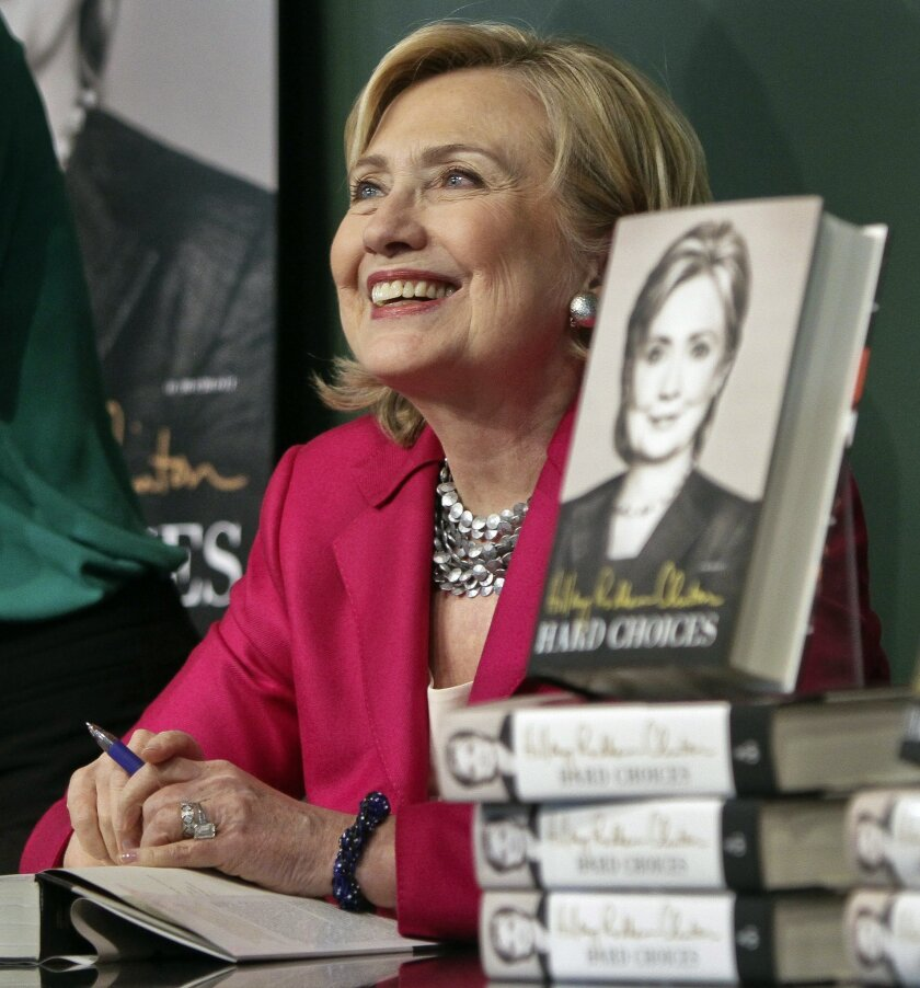 "HiIlary Rodham Clinton listens before signing a copy of her book, ""Hard Choices"" on Tuesday June 10, 2014, at Barnes and Noble bookstore in New York. Clinton said Tuesday that she and former President Bill Clinton ""fully appreciate how hard life is for so many Americans,"" seeking to refine remarks she made about the pair being broke when they left the White House while on a high-profile media tour for a new book. (AP Photo/Bebeto Matthews)"