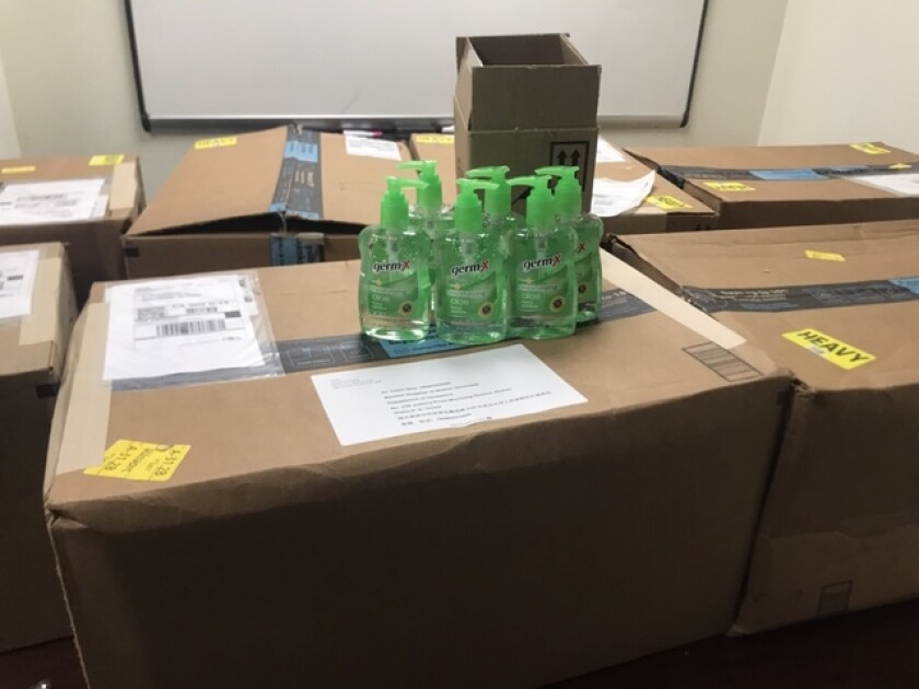 Boxes of hand sanitizer headed to China due to CCA student Andrew Kuang's fundraiser.