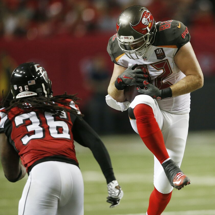 Tampa Bay Buccaneers tight end Brandon Myers (82) makes the catch ahead of Atlanta Falcons strong safety Kemal Ishmael (36) during the second of an NFL football game, Sunday, Nov. 1, 2015, in Atlanta. (AP Photo/John Bazemore)
